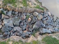 Rocks in the spill way on the wet lands , good habitat for frogs